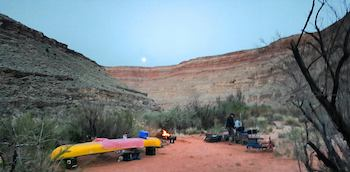Campers taking a break after canoeing down the San Juan River