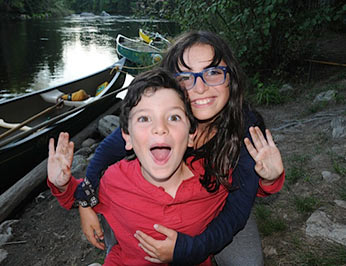 Two kids having fun after a long canoe trip