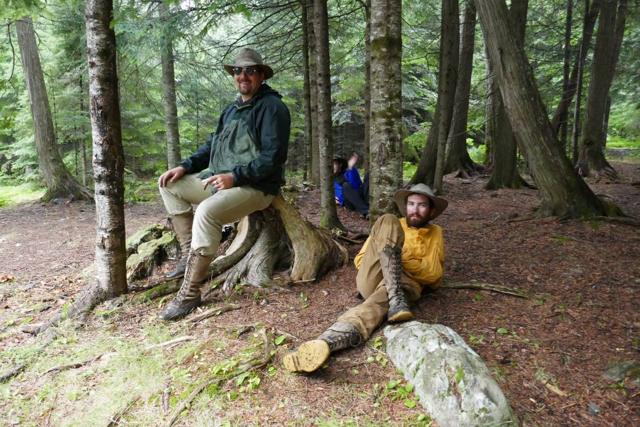 Smoking Rivers' Registered Maine Guides relaxing beside a river