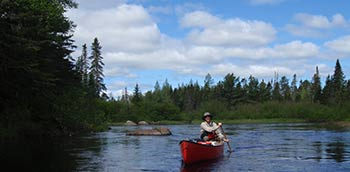 Dan in a canoe on the Machias River