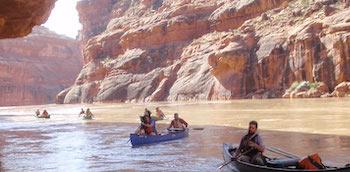 Paddlers canoeing the San Juan River